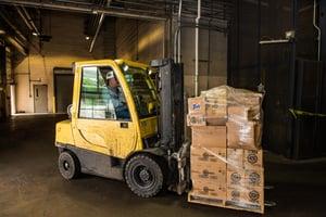 Forklift transports sealed boxes